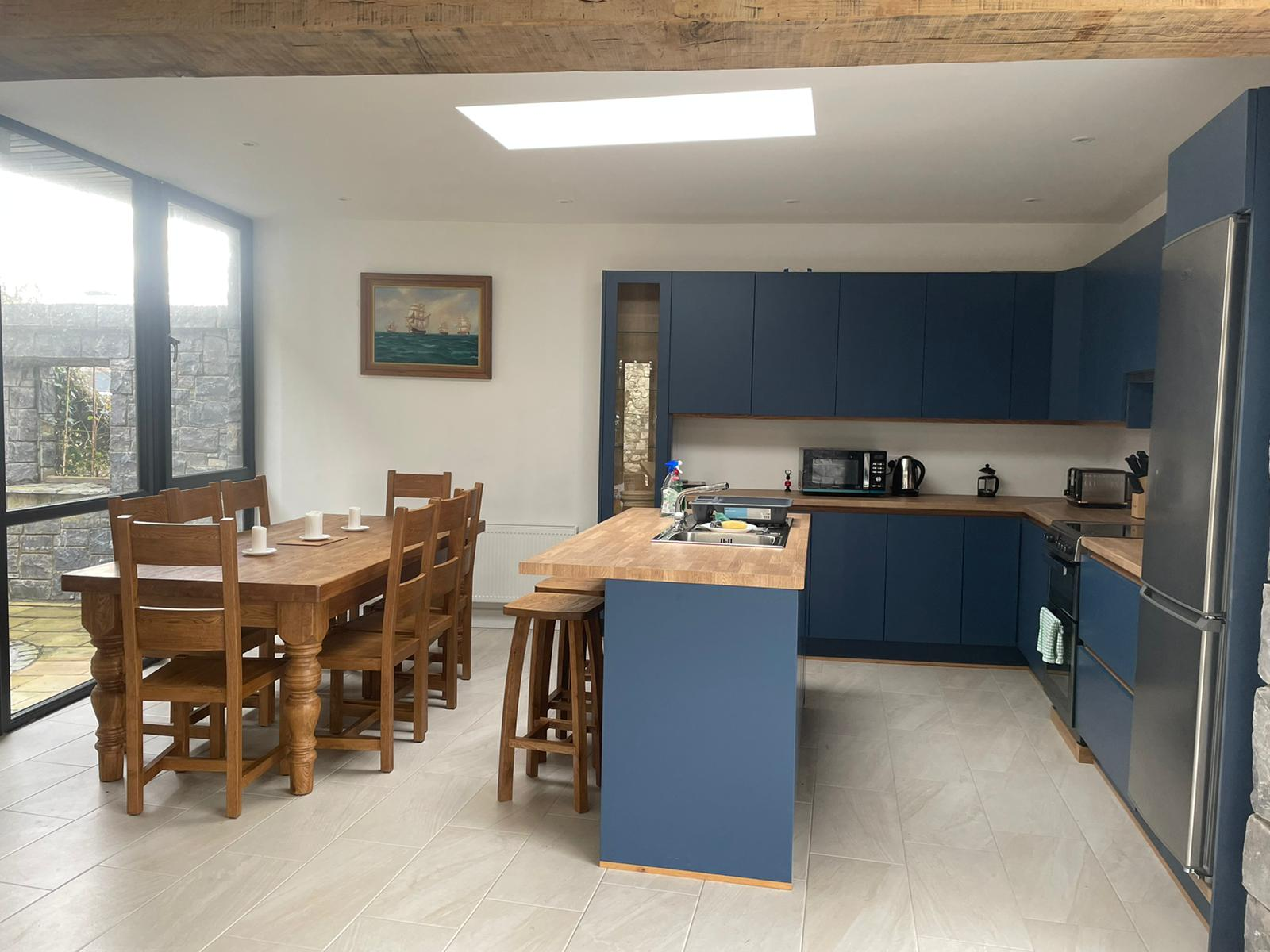 Kitchen and dining area from another angle at Heron Brook Lodge - Luxury Stay